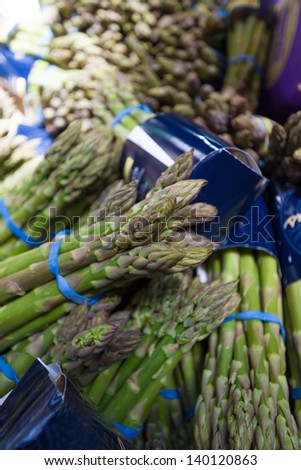 Bunches of asparagus for sale at farmers' market. Shallow depth of field. - stock photo