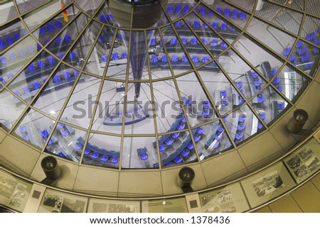 Bundestag conference hall at night in reichstag building, Berlin. Reichstag is a residence of German Parliament. - stock photo