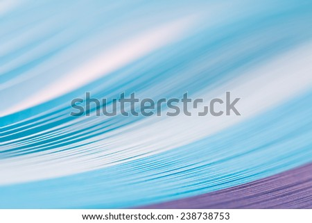 bundle colored paper ribbon on a white background. Macro lens closeup shot 1:1 - stock photo