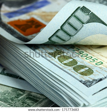Bundle of new hundred dollar bills - stock photo