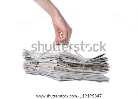 Bundle of newspaper tied with string ready for recycling - stock photo
