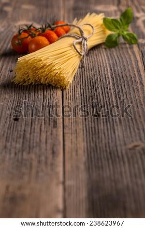 Bundle of uncooked dried Italian spaghetti  - stock photo