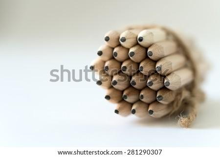 Bundle of wooden pencils isolated on white background - stock photo