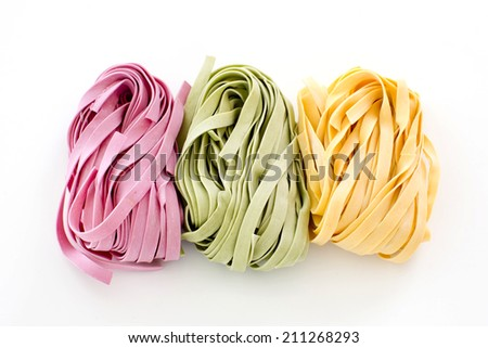 Bundles of dried ribbon color  pasta - stock photo