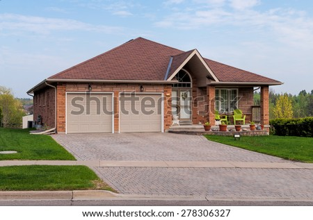 Bungalow house with a porch - stock photo