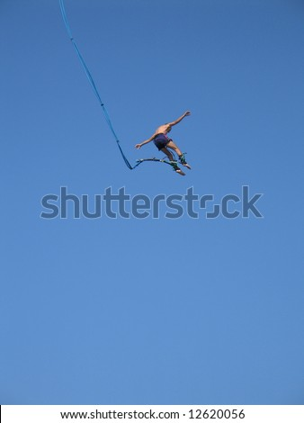 Bungee jumper high in the sky - stock photo