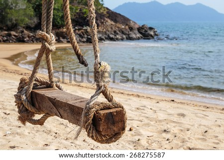 Bungee jumping on the beach of a tropical island - stock photo