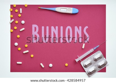 Bunions. Diagnosis. Sign on red background - stock photo
