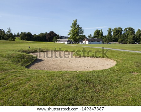 bunker on a golf course in the summer time - stock photo