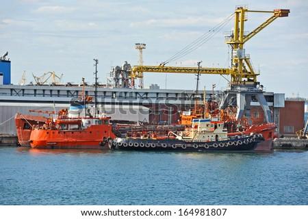 Bunker ship (fuel replenishment tanker) under port crane, Odessa, Ukraine - stock photo