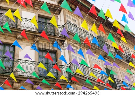 Bunting, colorful party flags with residential building on background - stock photo