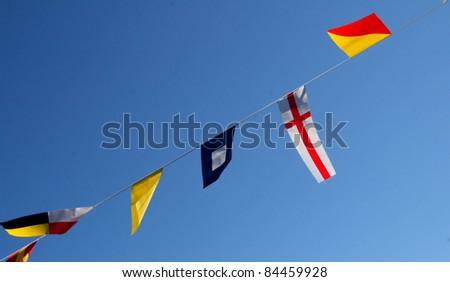 Bunting in Blue Sky - stock photo