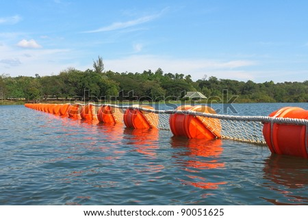 Buoy.Buoys in the water to prevent water in the dam. - stock photo