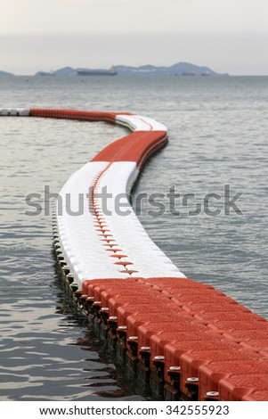 Buoys at sea to prevent ships from entering the area - stock photo