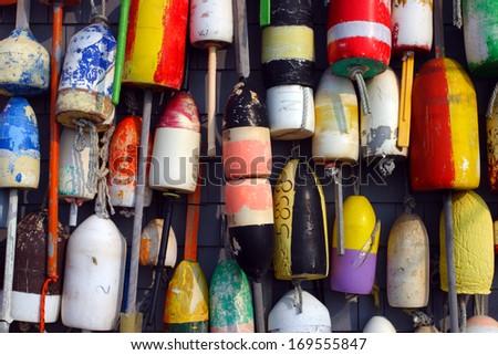 Buoys on the side of a beach shack   - stock photo