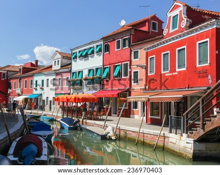 BURANO, ITALY - JULY 16, 2012: Streets and chanals and colorful houses on the famous island Burano, Venice. Venice and the Venetian lagoon are on the UNESCO World Heritage List. july 16, 2012 - stock photo