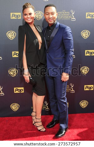 BURBANK - APR 26: Chrissy Teigen, John Legend at the 42nd Daytime Emmy Awards Gala at Warner Bros. Studio on April 26, 2015 in Burbank, California - stock photo