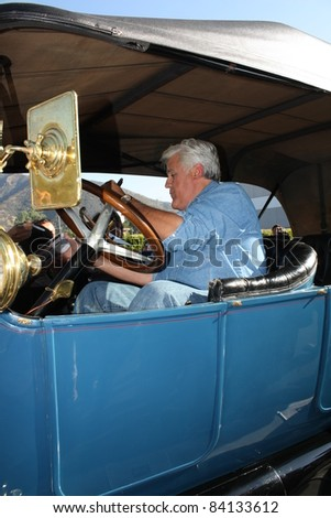 BURBANK CA - AUGUST 8: Comedian Jay Leno in his vintage car outside the NBC Studios August 8, 2011 Burbank, CA. - stock photo