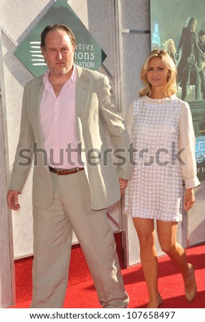 "BURBANK, CA - JULY 12, 2010: Director John Turtletaub & wife Amy at a benefit screening for his new movie ""The Sorcerer's Apprentice"" at Walt Disney Studios. - stock photo"