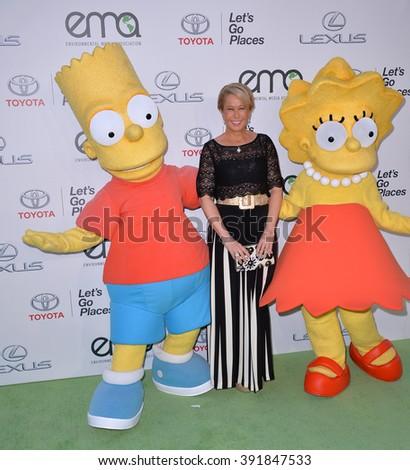BURBANK, CA - OCTOBER 24, 2015: Simpson's voice actress Yeardley Smith & Bart Simpson & Lisa Simpson characters at the 25th Annual Environmental Media Awards at Warner Bros. Studios, Burbank - stock photo