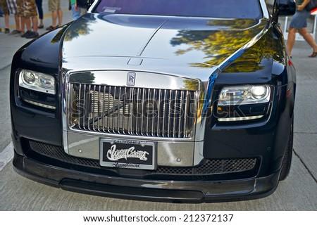 BURBANK/CALIFORNIA - JULY 26, 2014: Rolls Royce customized by West Coast Customs on display at the Burbank Car Classic July 26, 2014, Burbank, California USA  - stock photo