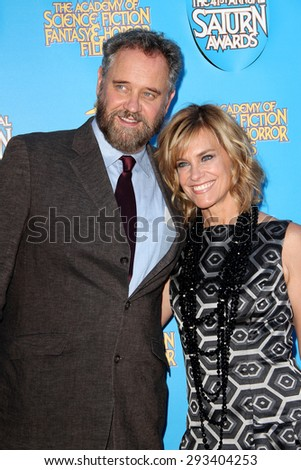 BURBANK - JUNE 25: Lance Guest and Catherine Mary Stewart arrive at the 41st Annual Saturn Awards on Thursday, June 25, 2015 at the Castaway Restaurant in Burbank, CA. - stock photo