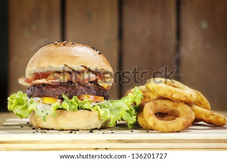 Burger and Onion Rings - stock photo