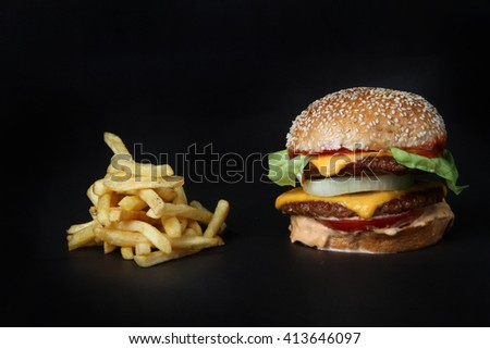 burger beef with potatoes french fries  American junk fast food hamburger with cheese cheeseburger - stock photo