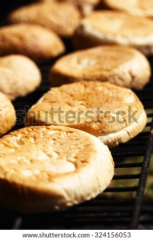 Burger buns on the grill BBQ - stock photo