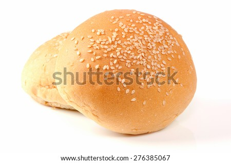 Burger buns sprinkled with sesame seeds on a white background. - stock photo