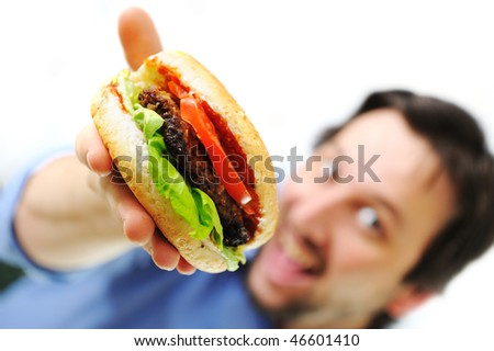 Burger, fast food, man holding and smiling - stock photo