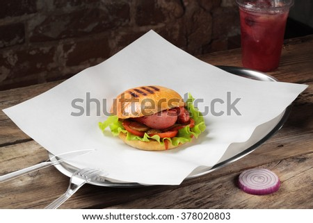 Burger on a plate with white paper  - stock photo