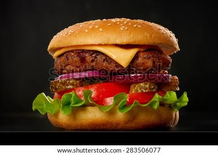 Burger on black background. - stock photo