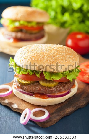 burger with beef patty lettuce onion tomato ketchup - stock photo