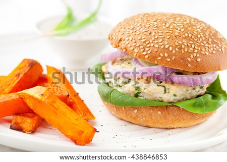 Burger with turkey, spinach, onion and roasted sweet potato, batat on a white background - stock photo