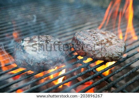 Burgers cooking on a Barbeque - stock photo