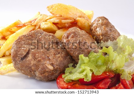 burgers with fries, salad and peppers - stock photo