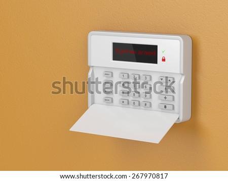 Burglar alarm keypad on orange wall - stock photo