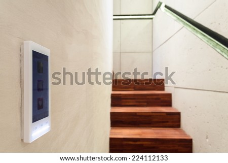 Burglar alarm situated on wall in the hall - stock photo