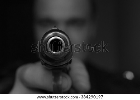 burglar or terrorist in black mask shooting with gun black - stock photo
