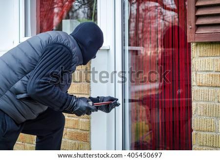 Burglary in progress - stock photo
