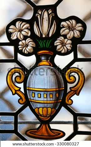 BURGOS, SPAIN - AUGUST 13, 2014: Stained Glass window depicting a vase with white flowers in the Cathedral of Burgos, Castille, Spain - stock photo