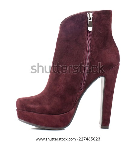 Burgundy suede boot isolated on white background. - stock photo