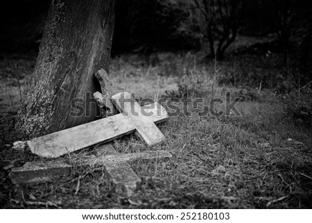 Burial cross in a graveyard - Black and white version   - stock photo