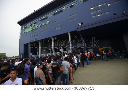 Buriram, Thailand- AUG1: Fans cheer in fornt stadium during the competition Thai Premier League 2015 between Buriram Utd. and Muangthong Utd. at I-Moblie Stadium on August 1, 2015 in Buriram, Thailand - stock photo