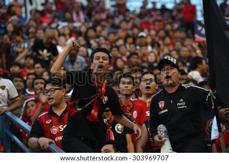 Buriram, Thailand - AUG 1: Fans cheering in action during the competition Thai Premier League 2015 between Buriram Utd. and Muangthong Utd. at I-Moblie Stadium on August 1, 2015 in Buriram, Thailand. - stock photo