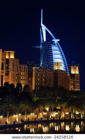 Burj Al Arab at night. View from Madinat Jumeirah. - stock photo