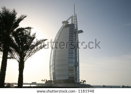 Burj al Arab behind palm trees - stock photo