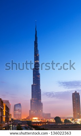 Burj Al-Khalifa is the tallest building in Dubai and in the world, which is situated in the downtown Dubai. - stock photo