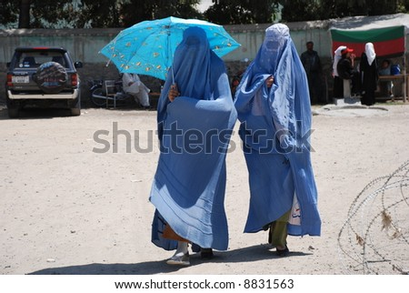 stock-photo-burka-and-umbrella-8831563.j
